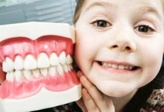 Выравнивание зуба в домашних условиях